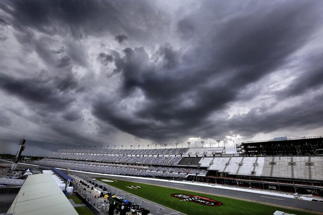 Storms clouds tower over Daytona International Speedway as qualifying for the NASCAR Sprint Cup auto race was canceled in Daytona Beach, Fla., Saturday, July 4, 2015. (Photo by Joe Burbank/Orlando Sentinel via AP Photo)