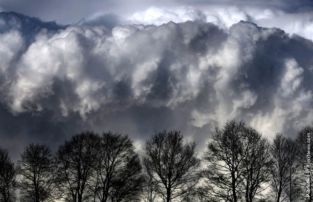 A cloudy sky is pictured above an Allgaeu landscape near Geislatsried, Germany, April 10, 2012