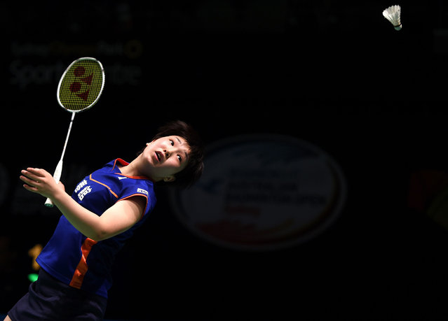 Japan's Akane Yamaguchi hits a return to China's Sun Yu during their women's singles quarter-final at the Australian Badminton Open tournament in Sydney on June 10, 2016. (Photo by Saeed Khan/AFP Photo)