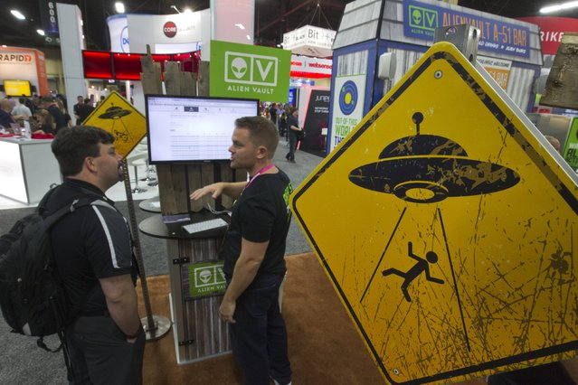 Alien abduction warning signs are posted in the AlienVault booth during the Black Hat USA 2015 cybersecurity conference in Las Vegas, Nevada August 5, 2015. AlienVault makes a unified security management platform for businesses, a representative said. (Photo by Steve Marcus/Reuters)