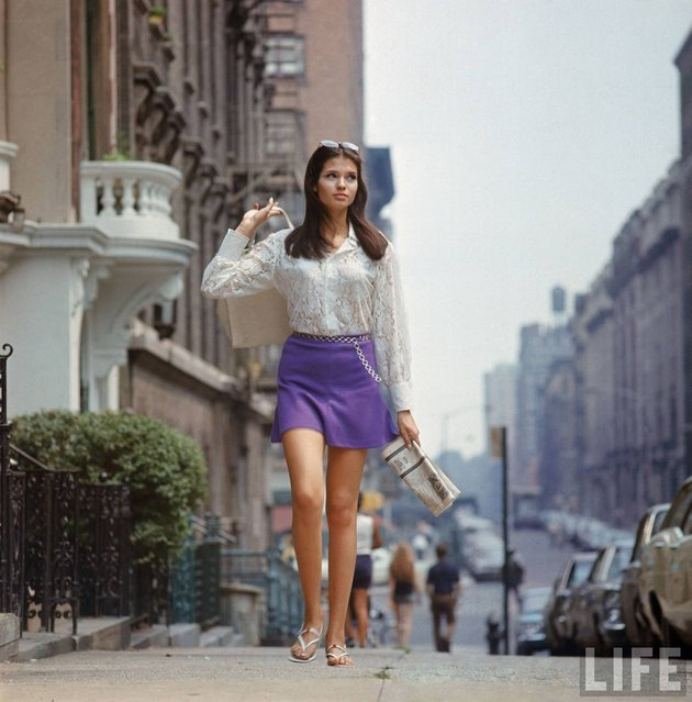 Woman (possibly model), with long hair wearing short skirt, lace top & sandals, walking up street in New York, 1969. (Photo by Vernon Merritt III/Time & Life Pictures/Getty Image)