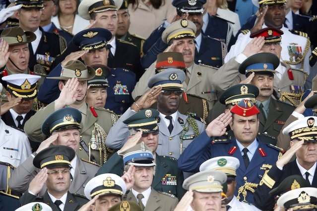 High ranking officers from various countries salute during the traditional Bastille Day parade on the Place de la Concorde in Paris, July 14, 2014. The year 2014 marks the 100th anniversary of the start of the First World War. (Photo by Charles Platiau/Reuters)