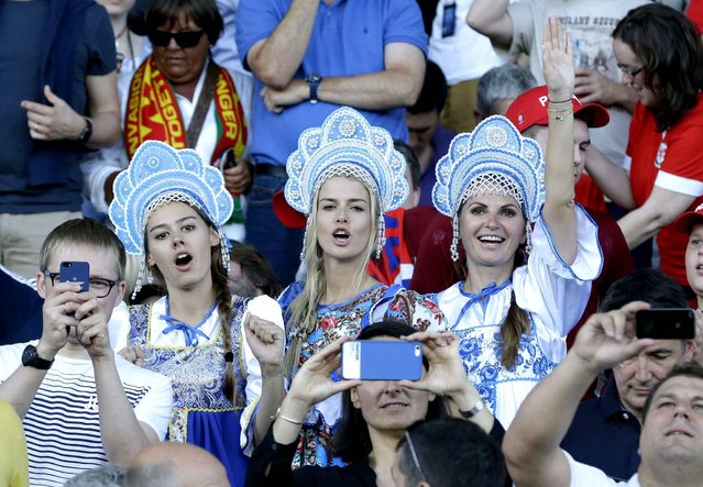 Russian fans wearing traditional outfits cheer from the stands before the Euro 2016 Group B soccer match between Russia and Wales at the Stadium municipal in Toulouse, France, Monday, June 20, 2016. (Photo by Thanassis Stavrakis/AP Photo)