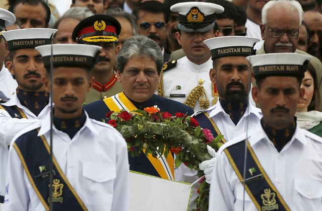 Ishrat ul Ebad, Governor Sindh province (C) walks with Pakistan Naval officers to lay a wreath during a ceremony to celebrate the country's 69th Independence Day at the mausoleum of Muhammad Ali Jinnah in Karachi, Pakistan, August 14, 2015. (Photo by Akhtar Soomro/Reuters)