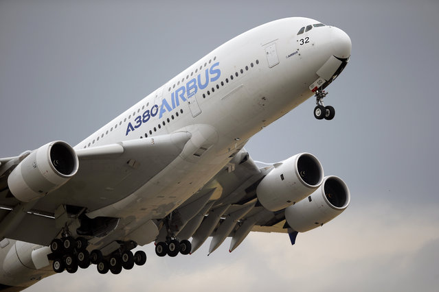 In this June 18, 2015, file photo, an Airbus A380 takes off for its demonstration flight at the Paris Air Show in Le Bourget airport, north of Paris. Commercial airliner maker Airbus is releasing 2019 earnings on Thursday, Feb. 12. (Photo by Francois Mori/AP Photo/File)