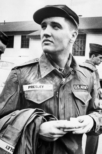 Elvis Presley contemplates his next two years of army service while awaiting issue of more Army clothing on March 26, 1958 in Fort Chaffee, Arkansas. Presley was sent to Fort Hood, Texas, for eight weeks of basic training with the tough Second Armored Division. (Photo by Bettmann/Bettmann Archive)