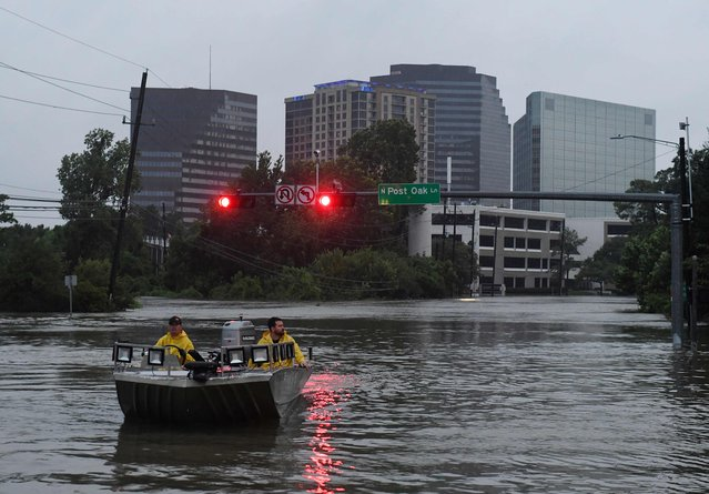 Rescue crews search for people in distress after Hurricane Harvey caused heavy flooding in Houston, Texas on August 27, 2017. Massive flooding unleashed by deadly monster storm Harvey left Houston – the fourth-largest city in the United States – increasingly isolated as its airports and highways shut down and residents fled homes waist-deep in water. (Photo by Mark Ralston/AFP Photo)
