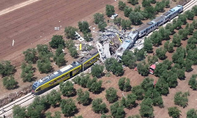 This handout picture released by the Italian firefighters Vigili del Fuoco press office on July 12, 2016 shows two smashed carriages thrown across the tracks in the incident, which happened on a single track stretch of line between Ruvo and Corato, in the southern Italian region of Puglia. The chief of the firefighting service in Bari said 10 people had been killed and dozens injured. (Photo by Vigili del Fuoco/AFP Photo)