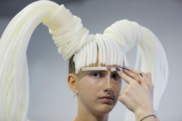 A model prepares backstage at Ukrainian Fashion Week in Kiev, Ukraine, September 9, 2017. (Photo by Valentyn Ogirenko/Reuters)