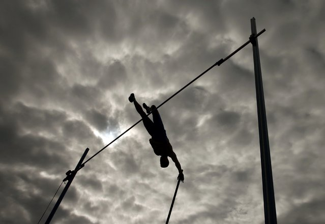 Sergey Kucheryanu of Russia competes in the men's pole vault final during the European Athletics Championships in Zurich August 16, 2014. (Photo by Phil Noble/Reuters)