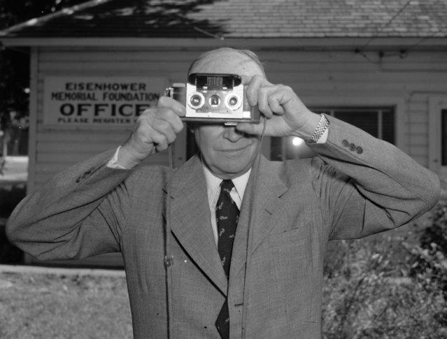 Gen. Dwight Eisenhower takes a snapshot of an AP photographer in Abilene, Kansas, June 6, 1952. (Photo by Preston Stroup/AP Photo)