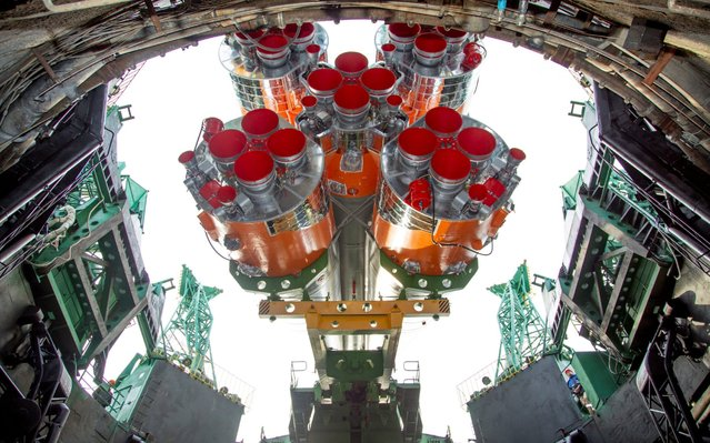 In this handout picture taken and released on April 6, 2020 by the Russian space agency Roscosmos, the Soyuz MS-16 spacecraft is mounted on the launch pad at the Russian-leased Baikonur cosmodrome in Kazakhstan. Members of the International Space Station (ISS) expedition 63, Russian cosmonauts Ivan Vagner and Anatoly Ivanishin and NASA astronaut Chris Cassidy, are preparing for the launch aboard the Soyuz MS-16 spacecraft on April 9, 2020. (Photo by Russian Space Agency Roscosmos/AFP Photo)
