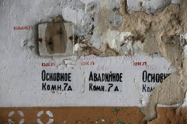 Signs in Russian are seen in the abandoned former Soviet R12 nuclear missile base in Zeltini, Latvia, July 22, 2016. (Photo by Ints Kalnins/Reuters)