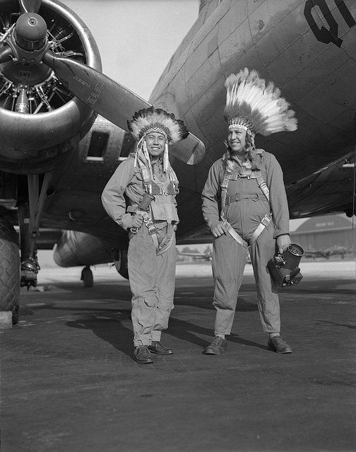 Gus Palmer (Kiowa, at left), side gunner, and Horace Poolaw (Kiowa), aerial photographer, in front of a B-17 Flying Fortress. MacDill Field, Tampa, Florida, ca. 1944. (Photo and caption by 2014 Estate of Horace Poolaw)