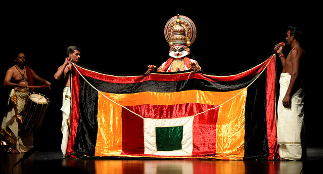 "Members of the Indian company Margi Kathakali theatre perform during ""Kijote Kathakali"", a Kathakali recital based on the Spanish classic ""Don Quixote"", at the Niemeyer Center in Aviles, northern Spain, July 29, 2016. (Photo by Eloy Alonso/Reuters)"
