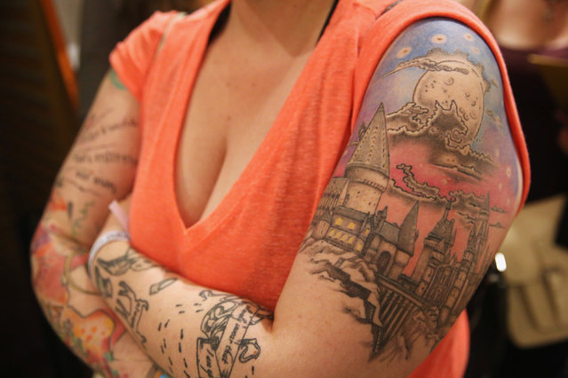 A fan shows her tattoos at an event to mark the release of the book of the play of Harry Potter and the Cursed Child parts One and Two at a bookstore in London, Britain July 30, 2016. (Photo by Neil Hall/Reuters)