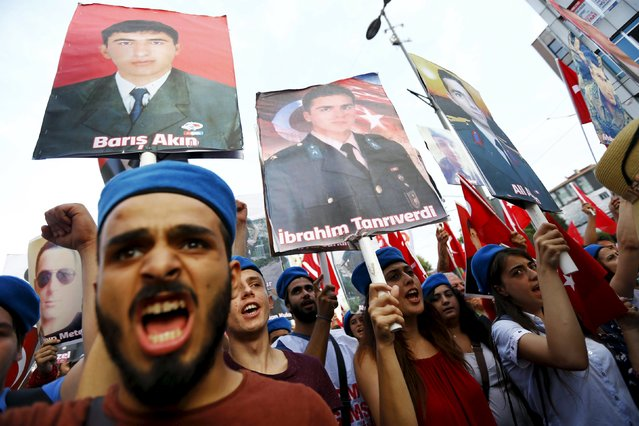 Demonstrators, wearing commando berets and holding pictures of the late Turkish army members who were killed by Kurdish militants, shout nationalist slogans during a protest against recent attacks on Turkish soldiers, in Istanbul, Turkey, September 7, 2015. Turkish warplanes bombed Kurdish insurgent targets overnight after the militants staged what appeared to be their deadliest attack since the collapse of a two-year-old ceasefire in July and killed 16 government soldiers. (Photo by Murad Sezer/Reuters)