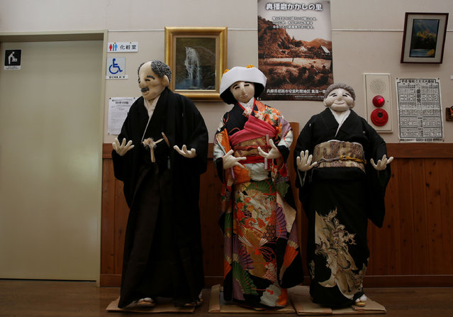 An illustration showing scarecrows dressed in traditional Japanese costume a shop is on display at Kakashi no Sato, or the Scarecrow's Hometown on September 10, 2014 in Himeji, Japan. (Photo by Buddhika Weerasinghe/Getty Images)