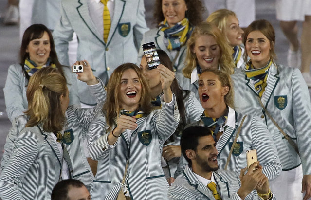 Australian athletes take a selfie as they march during the opening ceremony for the 2016 Summer Olympics in Rio de Janeiro, Brazil, Friday, August 5, 2016. (Photo by Matt Slocum/AP Photo)