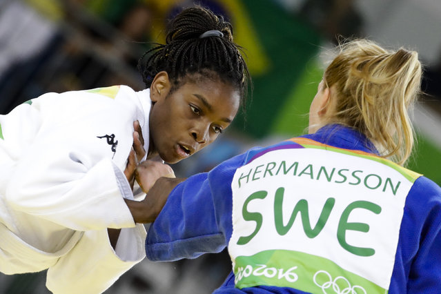 Italy's Edwige Gwend, white, competes against Sweden's Mia Hermansson during the women's 63-kg judo competition at at the 2016 Summer Olympics in Rio de Janeiro, Brazil, Tuesday, August 9, 2016. (Photo by Markus Schreiber/AP Photo)