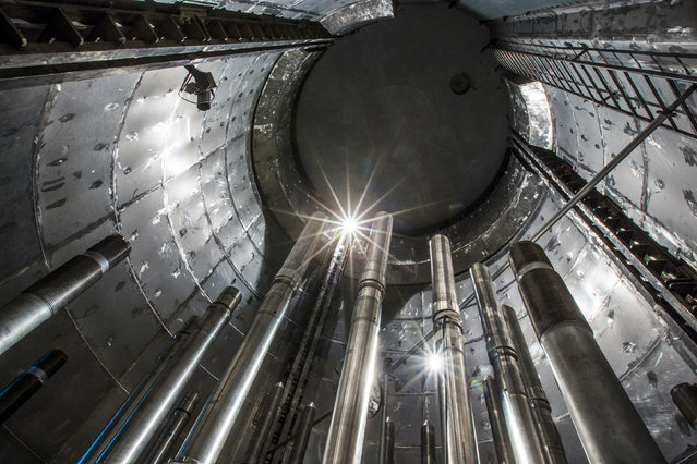 A view of the concrete case surrounding the pressure vessel of the reactor is seen inside the decommissioned Unit Six of the Greifswald nuclear power station outside Lubmin August 5, 2014. (Photo by Thomas Peter/Reuters)