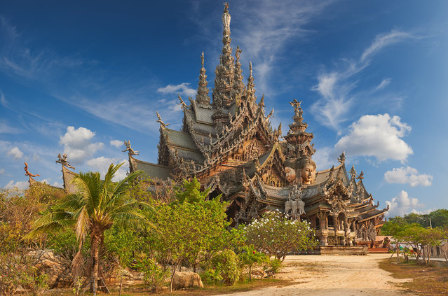 Thailand's Sanctuary of Truth is an all-wood building filled with sculptures based on traditional Buddhist and Hindu motifs. It is covered in intricate wood carvings, meant to depict complex ideas about ancient thought, human responsibility, and the cycle of life. (Photo by Yury Taranik/Getty Inages)