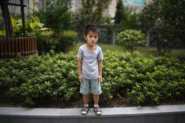 "Qin Wuyue, who was born in 2010, poses for a photograph in Shanghai August 22, 2014. When asked if he would like to have siblings, Wuyue said: ""No they're noisy"". (Photo by Carlos Barria/Reuters)"