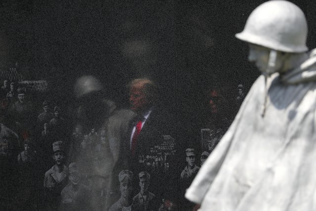 U.S. President Donald Trump and first lady Melania Trump are reflected in a memorial wall as they arrive for a wreath laying ceremony at the Korean War Veterans Memorial in Washington, U.S., June 25, 2020. (Photo by Tom Brenner/Reuters)