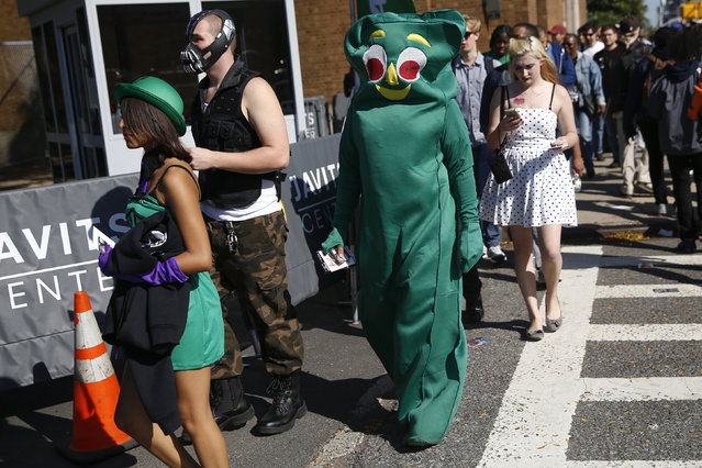 People dressed in costume enter New York's Comic-Con convention October 9, 2014. (Photo by Shannon Stapleton/Reuters)