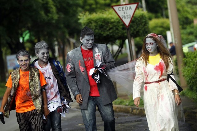 People dressed as zombies take part in a Zombie race to raise funds for children with cancer at the child Hospital Manuel de Jesus Rivera in Managua October 19, 2014. (Photo by Oswaldo Rivas/Reuters)