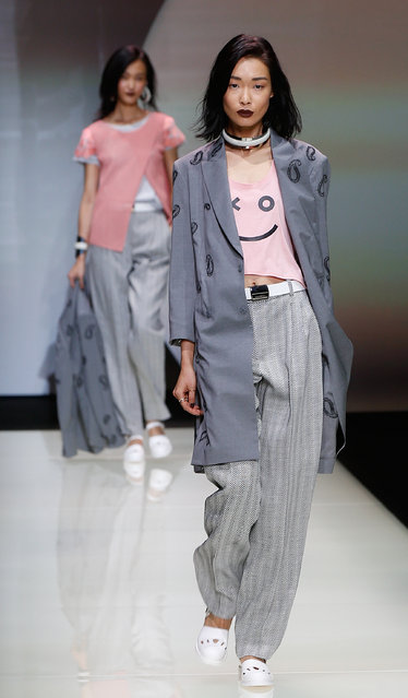 A model wears a creation for Emporio Armani women's spring-summer 2016 collection, part of the Milan Fashion Week, unveiled in Milan, Italy, Friday, September 25, 2015. (Photo by Luca Bruno/AP Photo)