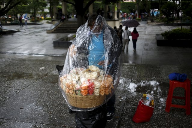 A street vendor is covered with plastic during rain in downtown Chilpancingo, in the Mexican state of Guerrero, September 28, 2015. Tropical storm Marty grew stronger as it rolled towards Mexico's Pacific coast on Sunday and could become a hurricane later in the day, the U.S. National Hurricane Center (NHC) said. Located some 235 miles (378 km) southwest of the tourist resort of Acapulco. (Photo by Jorge Dan Lopez/Reuters)