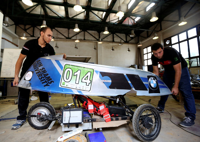 Egyptian university students work on a hybrid racing car they built to compete at the Egypt's Global Hybrid-Electric Challenge in Cairo, Egypt September 2, 2016. (Photo by Mohamed Abd El Ghany/Reuters)