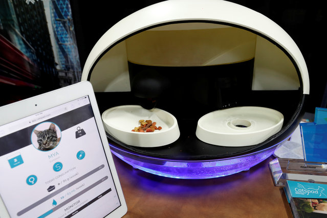 The Catspad smart pet assistant, with the ability to remotely schedule and control food portions, is displayed during CES Unveiled at the 2018 CES in Las Vegas, Nevada, U.S. January 8, 2018. (Photo by Steve Marcus/Reuters)