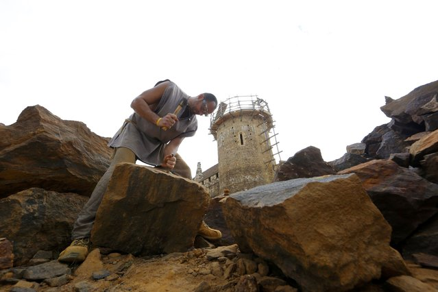 A stonecutter works at the construction site of the Chateau de Guedelon near Treigny in the Burgundy region of France, September 13, 2016. (Photo by Jacky Naegelen/Reuters)