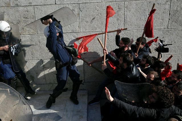 Protesters clash with riot police during a demonstration outside the parliament building against planned government reforms in Athens, Greece January 12, 2018. (Photo by Alkis Konstantinidis/Reuters)