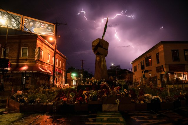 Lightning strikes above the George Floyd memorial in Minneapolis, Minnesota, U.S., August 14, 2020 as racial justice protests continue across the country. (Photo by Brandon Bell/Handout via Reuters)