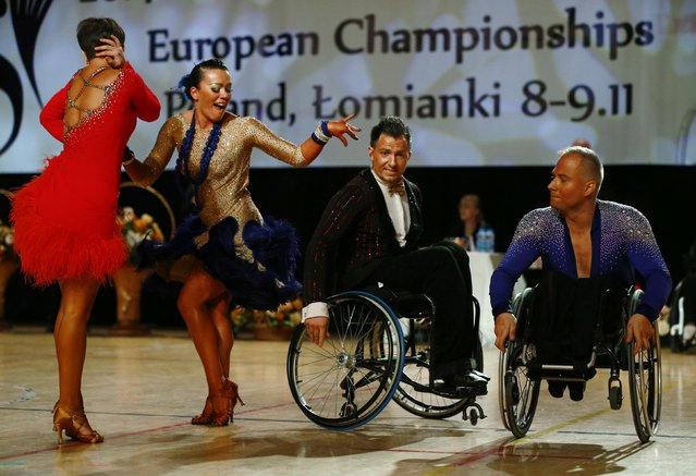 Pawel Karpinski (R) and Nadine Kinczel (2nd L) of Poland dance near Maksim Sedakov (2nd R) and Svetlana Kukushkina of Russia during IPC Wheelchair Dance Sport European Championships in Lomianki near Warsaw, November 9, 2014. (Photo by Kacper Pempel/Reuters)