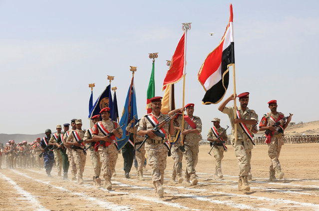 Pro-government soldiers march during a military parade celebrating the 54th anniversary of North Yemen's revolution in the central province of Marib September 27, 2016. (Photo by Ali Owidha/Reuters)