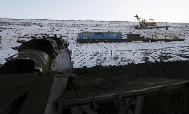 A rotary dredge works on the coal face of the Borodinsky opencast colliery, near the Siberian town of Borodino, east of Krasnoyarsk, Russia, October 27, 2015. (Photo by Ilya Naymushin/Reuters)