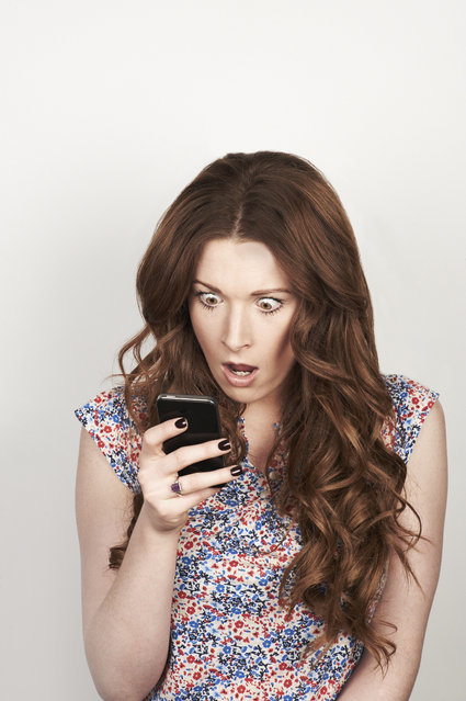 Portrait of woman using phone. (Photo by Flashpop/Getty Images)