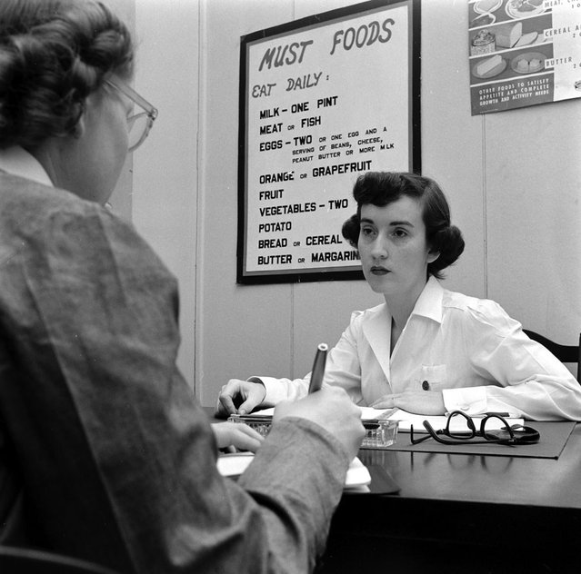 Dorothy Bradley (left), photographed for LIFE magazine article on obesity, meets with a nutritionist, 1949. (Photo by Martha Holmes/Time & Life Pictures)