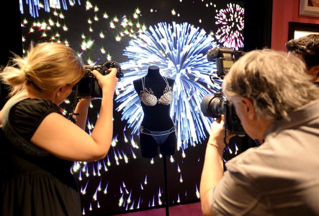 """The $2 million Mouawad Victoria's Secret Fantasy Bra, dubbed the """"Fireworks Fantasy Bra"""", is revealed at the Victoria's Secret store in Santa Monica, California November 2, 2015. The bra dazzles with over 6,500 precious gems of diamonds, blue topaz, yellow sapphires and pink quartz all set in 18-karat gold. (Photo by Kevork Djansezian/Reuters)"""