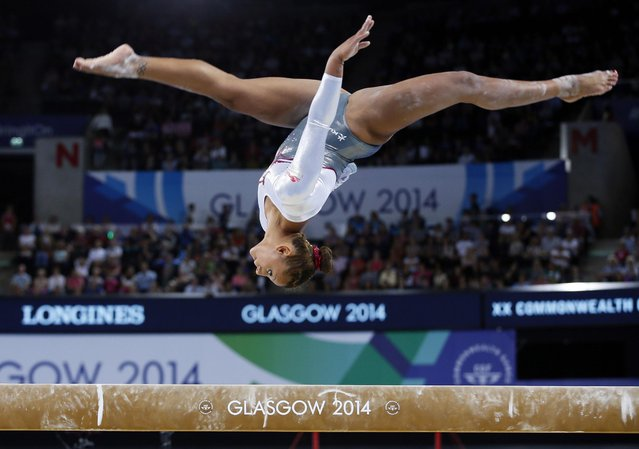 Claudia Fragapane of England leaps during her beam routine as she takes part in the women's team final and individual qualification gymnastic competition at the Commonwealth Games Glasgow 2014, in Glasgow, Scotland, Tuesday, July, 29, 2014. (Photo by Alastair Grant/AP Photo)