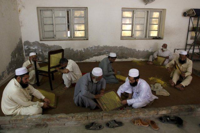 Visually impaired men weave chair seats and backs at the Government School and Institute for the Blind in Peshawar, Pakistan October 9, 2015. (Photo by Khuram Parvez/Reuters)