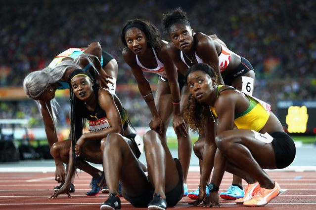 Elaine Thompson of Jamaica, Bianca Williams of England, Dina Asher-Smith of England and Shericka Jackson of Jamaica look at the scoreboard after the Women's 200 metres final during athletics on day eight of the Gold Coast 2018 Commonwealth Games at Carrara Stadium on April 12, 2018 on the Gold Coast, Australia. (Photo by Michael Steele/Getty Images)