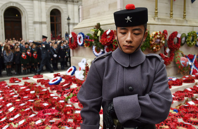 A member of the British Army Gurkha Rifles regiment stands to attention at the nations national war memorial, the Cenotaph on Whitehall during a service to mark Armistice Day in London, Britain, 11 November 2015.  Britain honoured its war dead on 11 November. (Photo by Andy Rain/EPA)