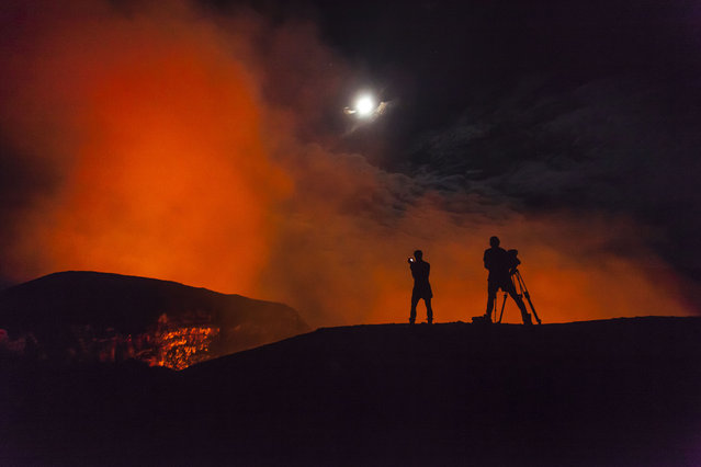 Exploirng the Marum Volcano in Vanuatu. (Photo by Bradley Ambrose/Caters News)