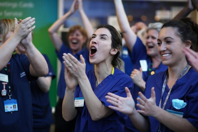 NHS workers applaud outside Chelsea and Westminster Hospital during the Clap for our Carers campaign in support of the NHS as the spread of the coronavirus disease (COVID-19) continues, London, Britain, April 9, 2020. (Photo by Kevin Coombs/Reuters)