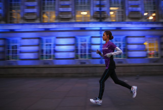 A jogger takes an early morning run in central London January 5, 2015. (Photo by Eddie Keogh/Reuters)